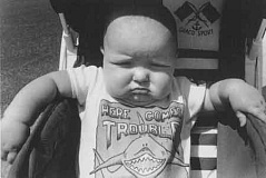 "Funny Pictures of Baby with ""Here Comes Trouble"" Sign"