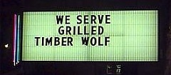 Funny Jokes Picture of a Sign Announcing Served Timber Wolf